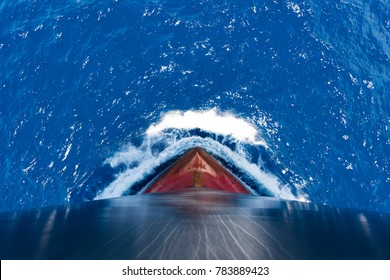 Ship's bow, moving through the waves to her destination. View from forecastle deck.