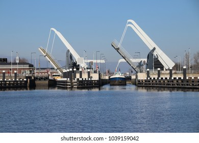 Ships coming out of the Julianasluis sluice in Gouda which connects rivers Gouwe and Hollandse IJssel in the Netherlands