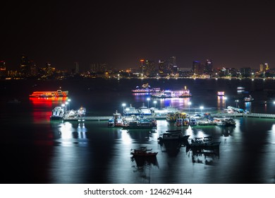 Ships and Ferries Pattaya City Marina Bay at Night with the City skyline in the background Thailand