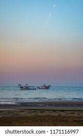 ships fishing in sea near bibione, italy