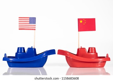 ships with the flags of united states and china in front of white background