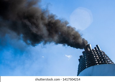 Ships funnel emitting black smoke, air pollution, carbon tax