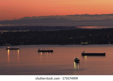 Ships in the harbor at sunset