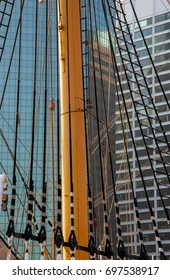 A ship's mast intermingles with glass and concrete at the seaport in Manhattan