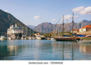 Ships near Old Town of Kotor on a sunny autumn day. Montenegro