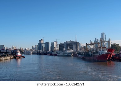 Ships at the port harbor of Buenos Aires, cityscape in the background, Argentina, South America. The Port is the leading transshipment point for the foreign trade of Argentina.