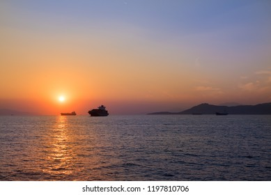Ships silhouette against sunset sky. Beautiful sea landscape.