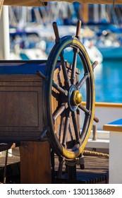 Ship's steering wheel, close-up. Navigation helm.