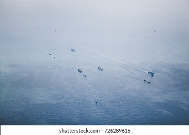 Ships in Straits of Singapore from the height. Ships stay on anchor and wait for their turn to enter the port for unloading or loading