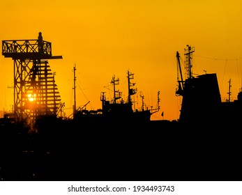 ships at sunset in the bay