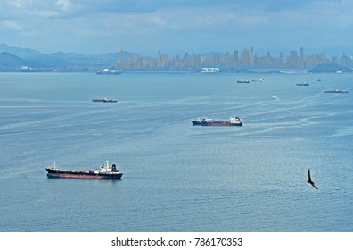 Ships waiting to enter the Panama Canal on the Pacific side.  Note the thriving city of Panama in the background