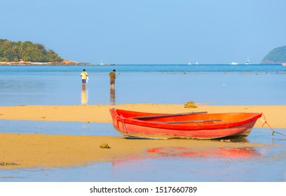 Ships, yachts and fishing boats at low tide at the bottom. Rawai Beach in Phuket, Thailand. Rawai Bay panorama at sunset at low tide with vessels lying at the bottom and reflected in the water