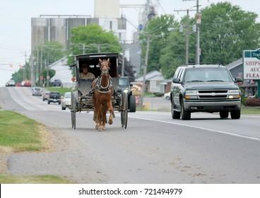 SHIPSHEWANA, INDIANA, USA - MAY 26, 2016: Amish horse and buggy in Northern Indiana's Amish Country, Shipshewana.