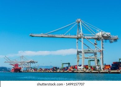 Ship-to-shore gantry crane at Oakland International Container Terminal built by Zhen Hua Port Machinery Company and managed by Stevedoring Services of America - Oakland, CA, USA - August 30, 2019