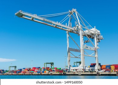 Ship-to-shore gantry crane at Oakland International Container Terminal built Zhen Hua Port Machinery Company and managed by Stevedoring Services of America - Oakland, California, USA - August 30, 2019