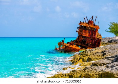 Shipwreck against the rocks along the turquoise shores of Bimini, Bahamas.