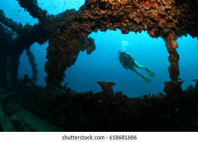 Shipwreck of the Baron Gautsch and scuba diver underwater in the Mediterranean Sea
