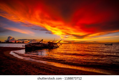 Shipwreck in Kratinglay beach Chonburi with beautiful sunset and twilight sky