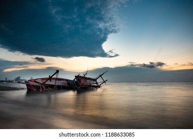 Shipwreck on a Beach with cloudy Sky