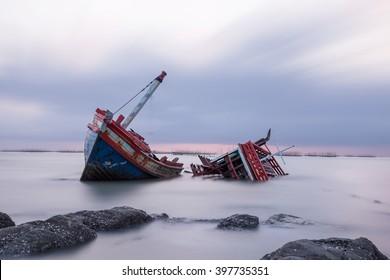 Shipwreck on a Beach with cloudy Sky, Thailand