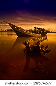 shipwreck of phinisi ship - Traditional wooden sailing ships at beach
