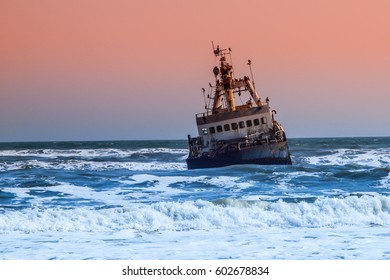 Shipwreck in wild Atlantic Ocean at Skeleton Coast, Namibia, Africa.
