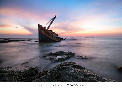 Shipwreck or wrecked boat on beach
