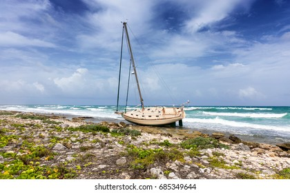 Shipwrecked sailing boat on the caribbean coast