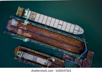 shipyard business and large shipbuilding cargo international transport on the sea in Thailand aerial view