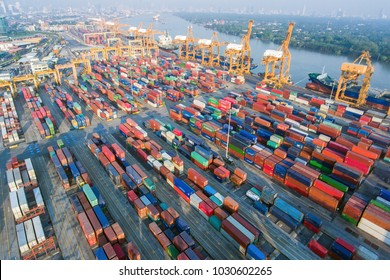 Shipyard with containers from aerial view waiting for loading into cargo ships for overseas shipping from shipyard.
