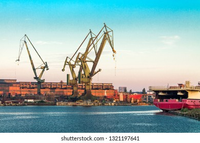 Shipyard with historical cranes in the industrial part of the city Gdansk (Gdańsk) in Poland (Polska). The shipyard is close to the old town of this beautiful city.