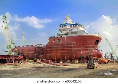 Shipyard industry ,Scaffolding and construction site ( ship building) Big ship on floating dry dock in shipyard. located at Port Klang , Malaysia