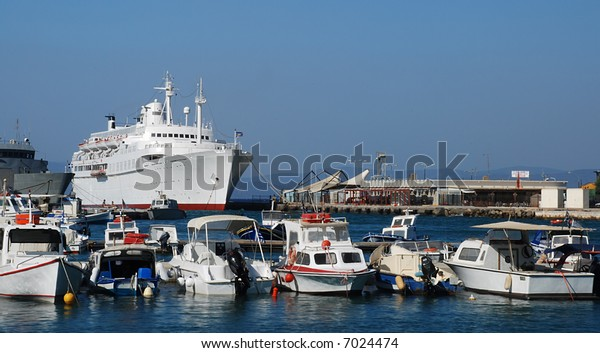Shipyard with small yachts and a big white cruise ship