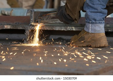 a shipyard steel worker burning steel
