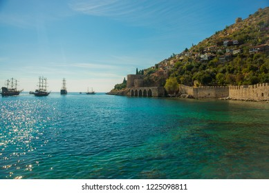 Shipyard Tersane, Alanya historical dockyard.Ships sailing on the sea. Alanya, Antalya district, Turkey, Asia