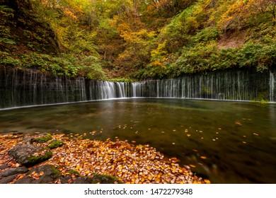 Shiraito fall in colorful autumn season, Karuizawa, Japan.