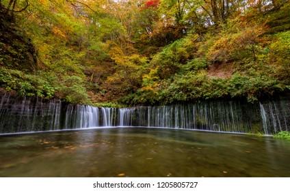 Shiraito water fall in autumn season at Karuizawa, Japan.