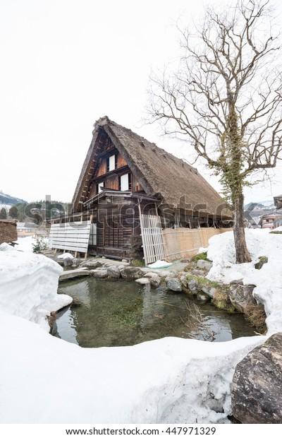 Shirakawa gusto house and small pond