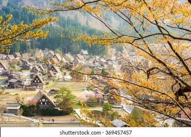 Shirakawa (Shirakawa-go) Beautiful Panorama Aerial View of The Historic Villages. Shirakawago Traditional Houses in Gassho Zukuri Style with Out of Focus Cherry Blossom Sakura Tree in Spring Season