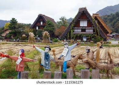 SHIRAKAWA-GO, JAPAN: OCTOBER 20, 2017: Scarecrows in front of traditional wooden houses in Shirakawa-go village, Japan
