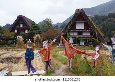 SHIRAKAWA-GO, JAPAN: OCTOBER 20, 2017: Scarecrows in front of traditional wooden houses in Shirakawa-go village, Japan