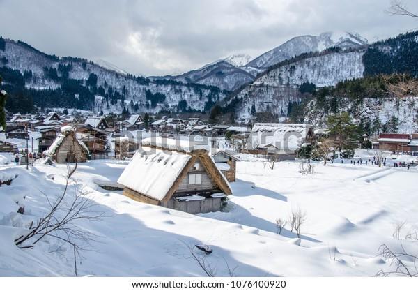 Shirakawa-go Village & Hotel in winter travel landmark of Gifu, Takayama, Japan Tour. Shirakawa go Beautiful view winter light up, sunlight, daylight, sunshine,  morning, Stock background free