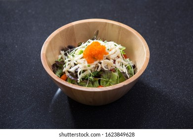 Shirauo or white fish salad in a wooden bowl, a Japanese cuosine