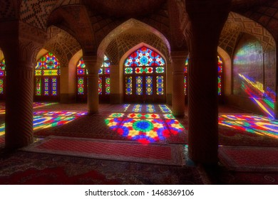 Shiraz, Iran, 11.15.2016: The interior of the pink mosque (The Nasir al-Mulk Mosque) in Shiraz, beautiful patterns of sunlight through multi-colored stained-glass windows