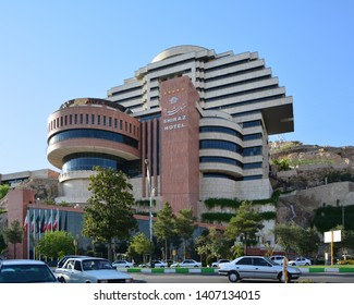Shiraz, Iran, 22 Aug. 2015: The spectacular modern building of Shiraz Hotel, with little stream flowing down the rock next to it.