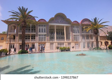 Shiraz, Iran - April 16 2019. The Ornamented pool with fountain, and date trees fronted the historic Qavam House within the Eram Garden in Shiraz, Iran.