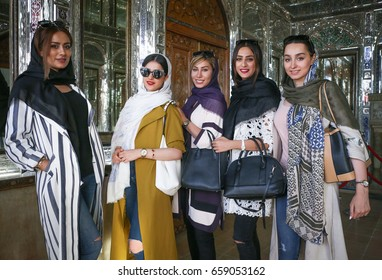 Shiraz, Iran - April 20, 2017: Group of young Iranian muslim women are standing in a famous landmark in Shiraz, Iran