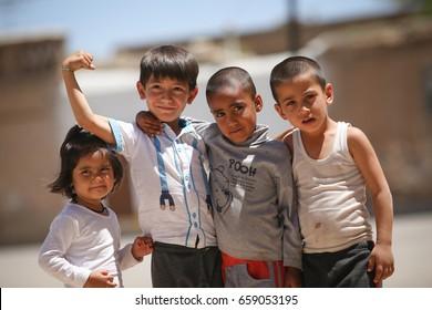 Shiraz, Iran - April 20, 2017: A group of unidentified Iranian children posing in the streets of Shiraz, Iran