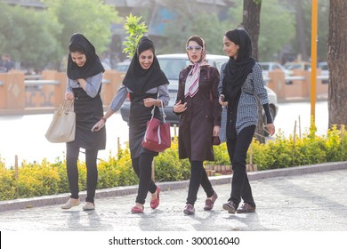 SHIRAZ, IRAN - APRIL 25, 2015: unidentified women walking in Shiraz, Iran