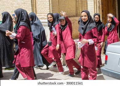 SHIRAZ, IRAN - APRIL 26, 2015: unidentified young female students out of school in uniform, in Shiraz, Iran